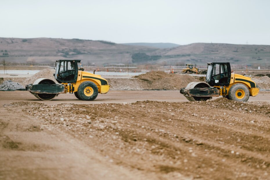 Two Vibratory Soil Compactors during road and highway construction.
